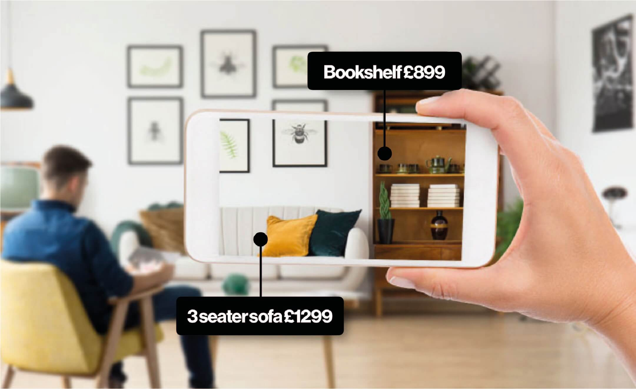 Hand holding a smartphone recording a video survey of a living room, with a man sat on an armchair. Items are highlighted showing a Bookshelf valued at £800 and a 3 seater couch valued at £1299.